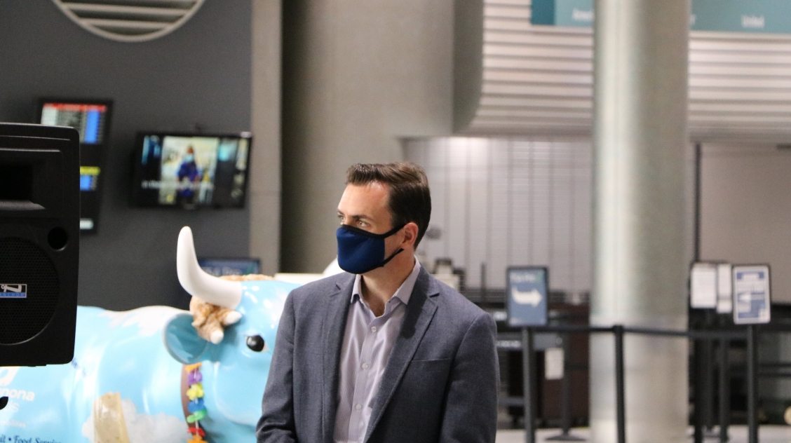 Rep. Gallagher wearing a mask at Austin Straubel Airport