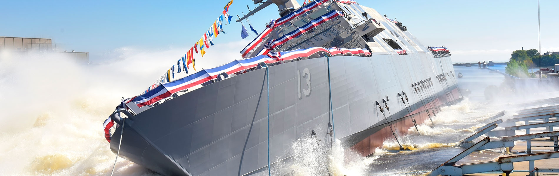 The 13th littoral combat ship, the future USS Wichita (LCS 13) launches sideways