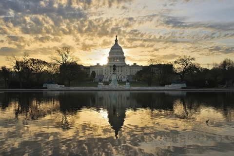 US Capitol Building with sunrise sky